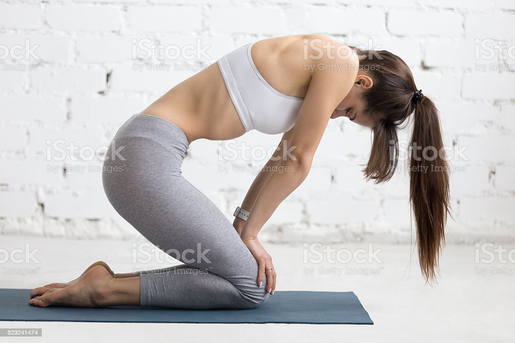 Yoga Indoors: Uddiyana Bandha stock photo