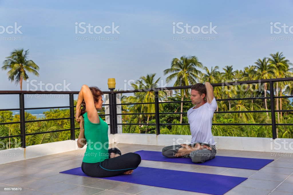 Yoga instructor and woman on the balcony stock photo