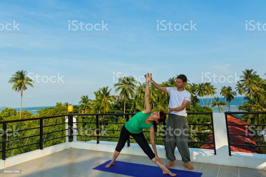 Yoga instructor and  woman stock photo