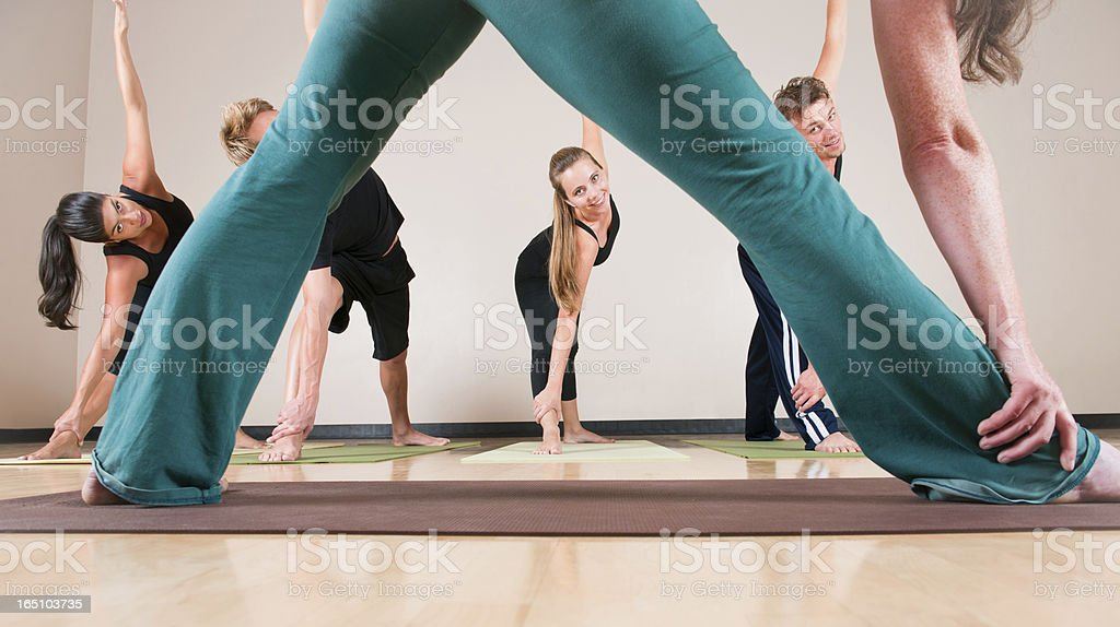 Yoga Instructor Leading Class (Interesting Perspective) stock photo