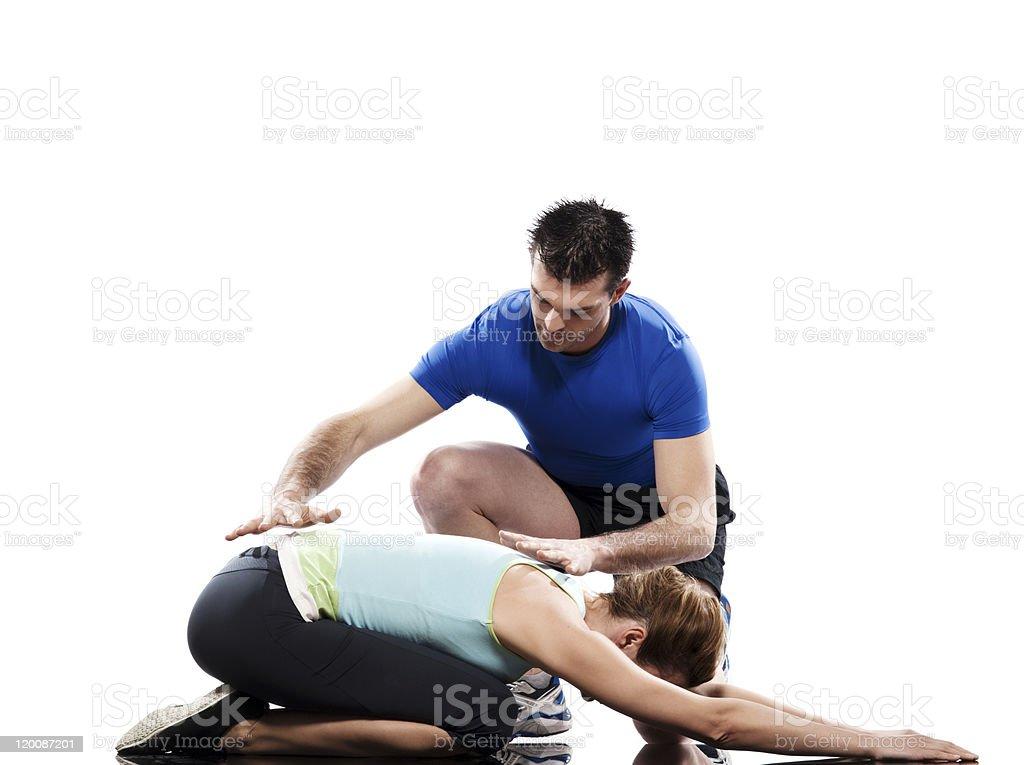 yoga instructor positioning woman adho mukha virasana child pose royalty-free stock photo