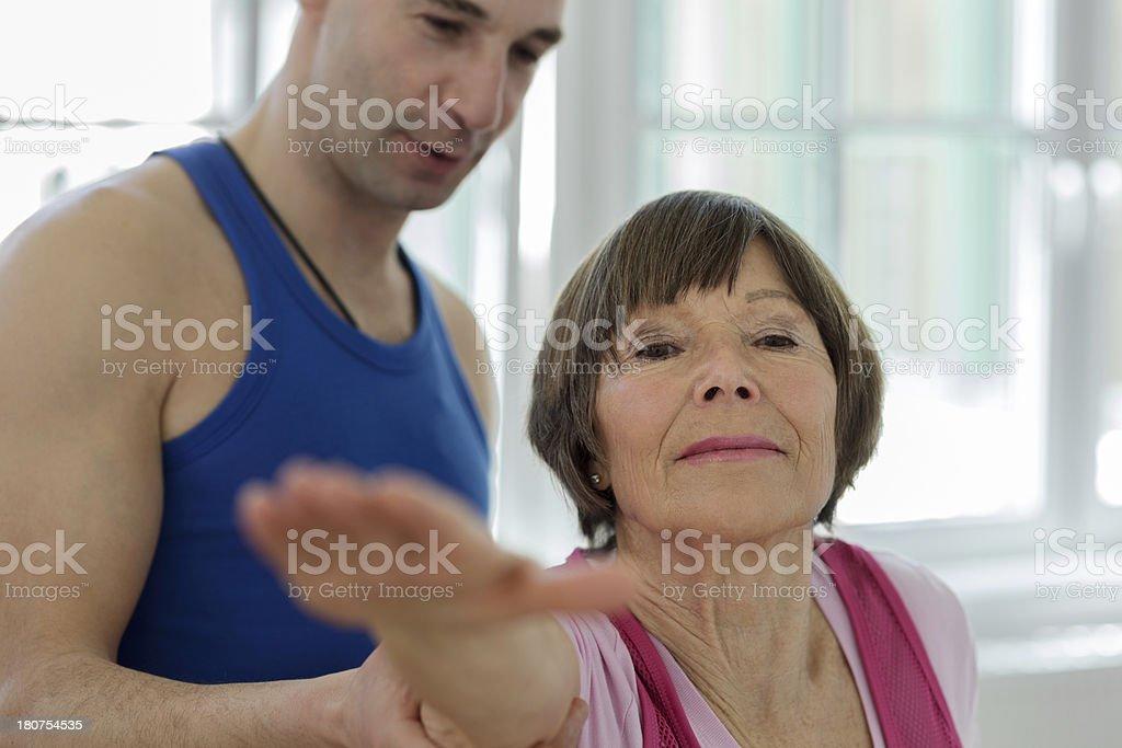Yoga Instructor showing seniors adult Warrior pose royalty-free stock photo