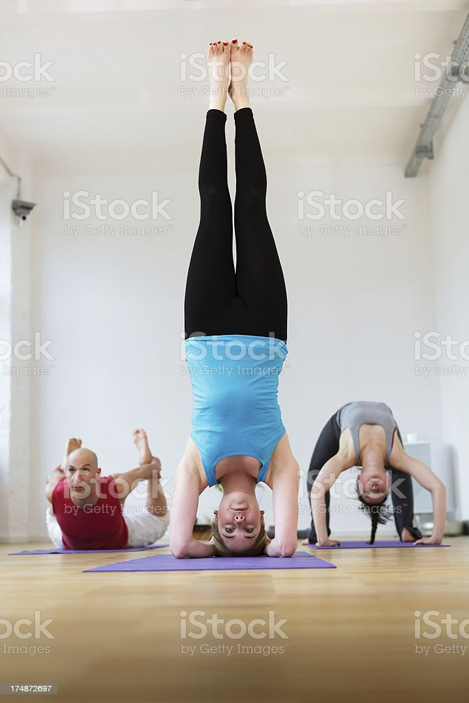 Yoga Instructor with Students royalty-free stock photo