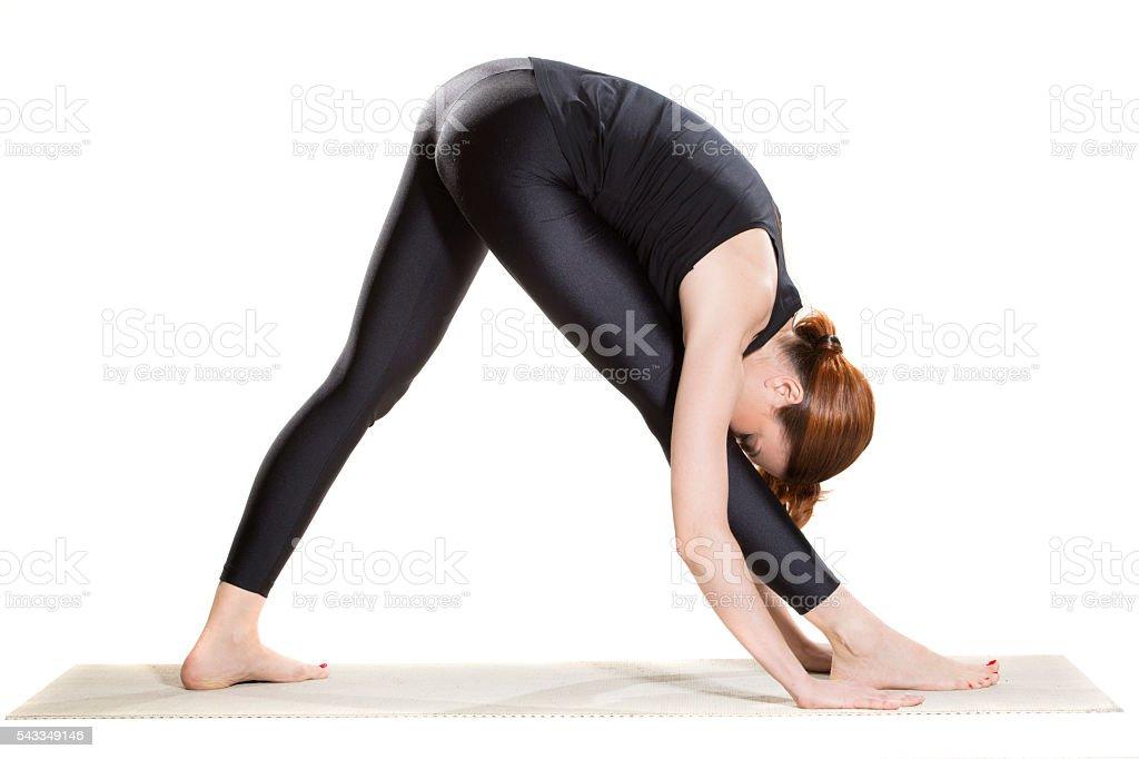 Yoga Intense Side Stretch Pose -Parsvottanasana stock photo