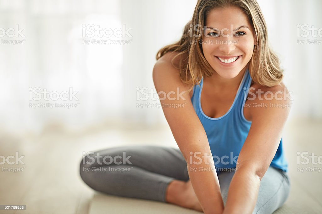 Yoga is an essential part of her lifestyle stock photo