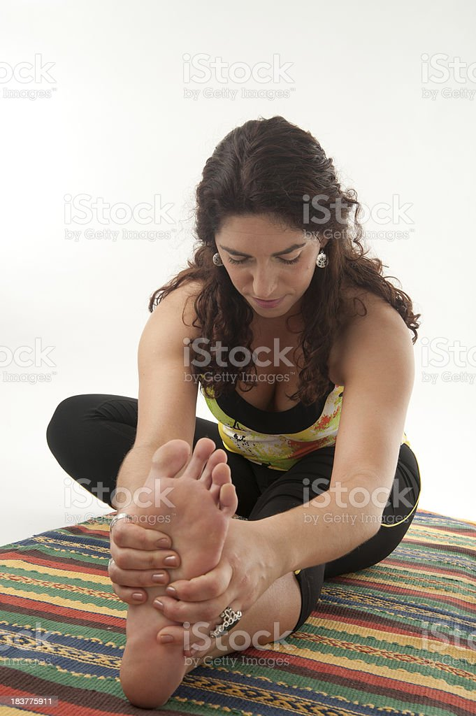 Yoga - Janu Sirsasana (Head-to-Knee Forward Bend) stock photo