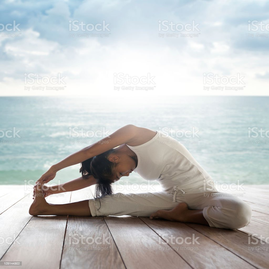Yoga: Janusirsasana (Head to Knee Pose) stock photo