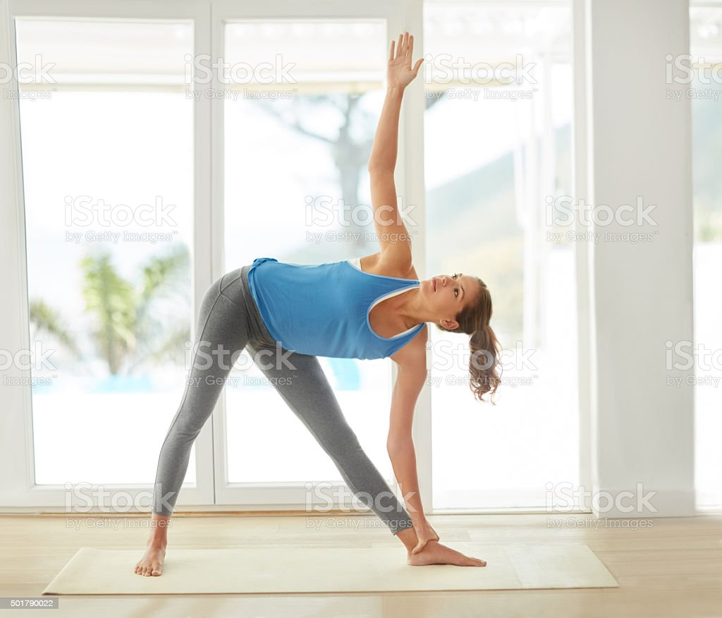 Yoga keeps her body flexible and strong stock photo