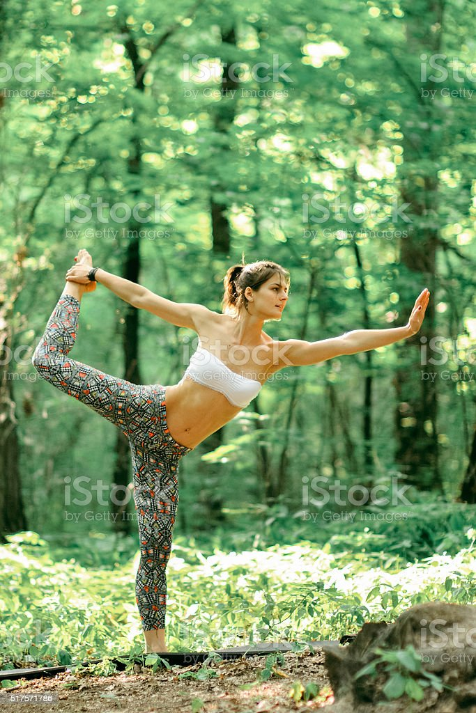 Yoga king of the dance pose by woman stock photo