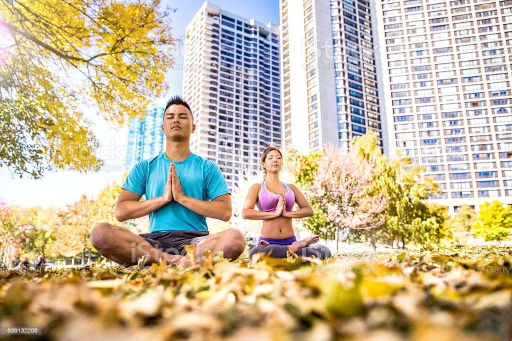 Yoga lessons in the city during lunch break stock photo