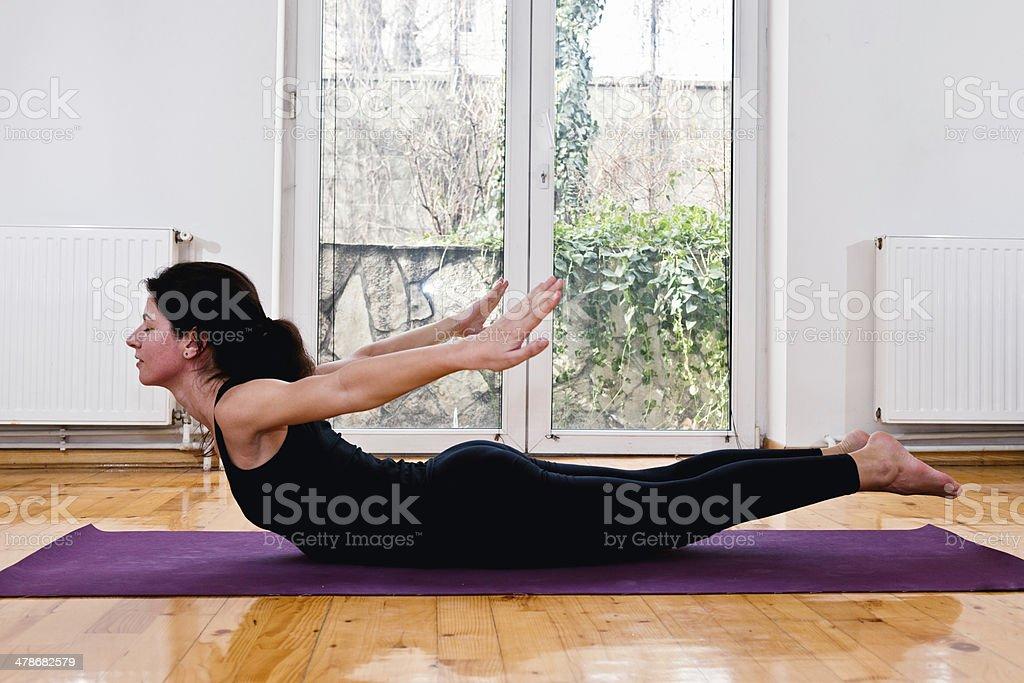 Yoga Locust Position stock photo