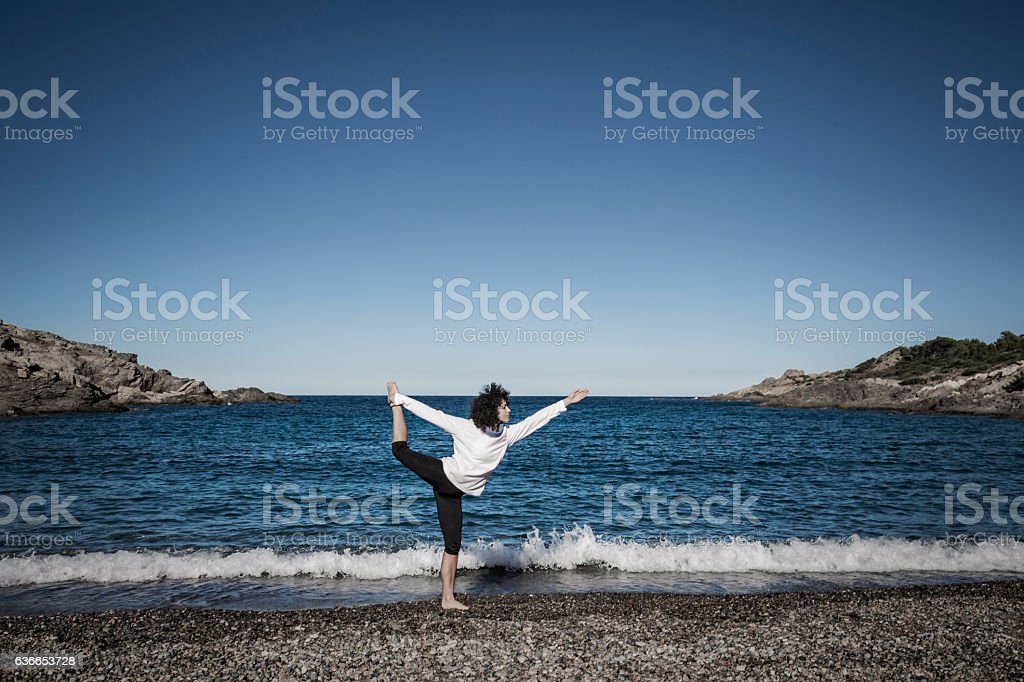 Yoga lord of the dance pose stock photo