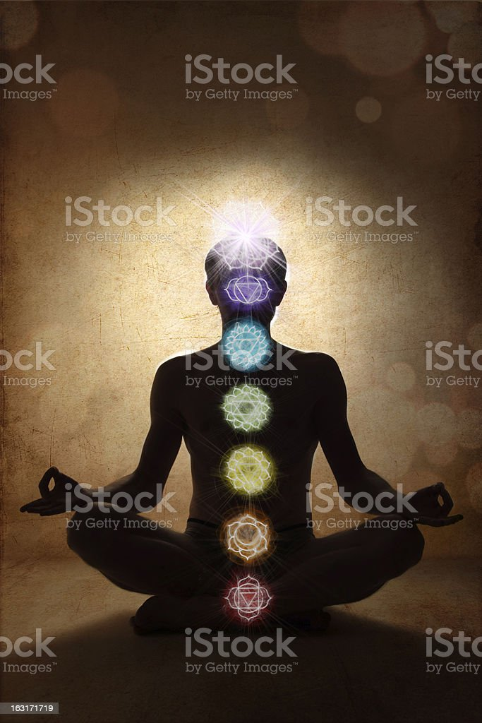 Yoga man in lotus pose with chakra symbols stock photo