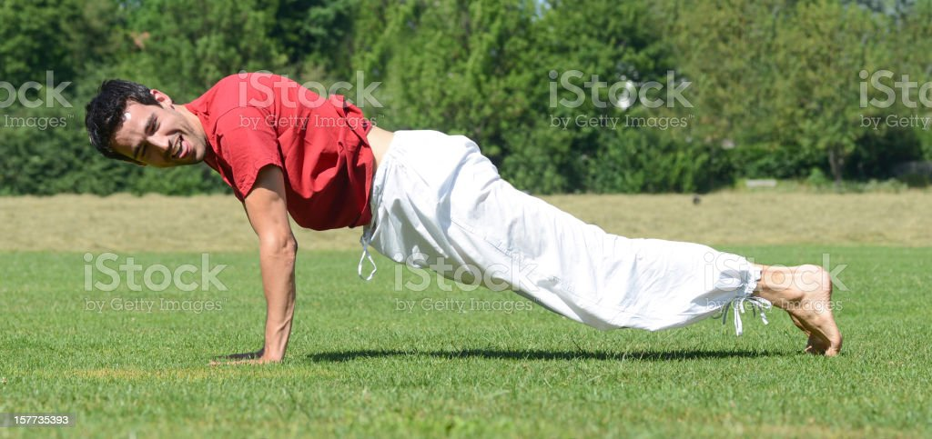 yoga man outdoor on meadow stock photo