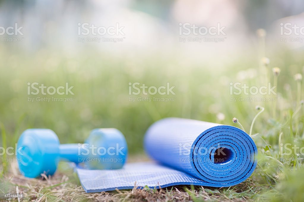 yoga mat on grass stock photo