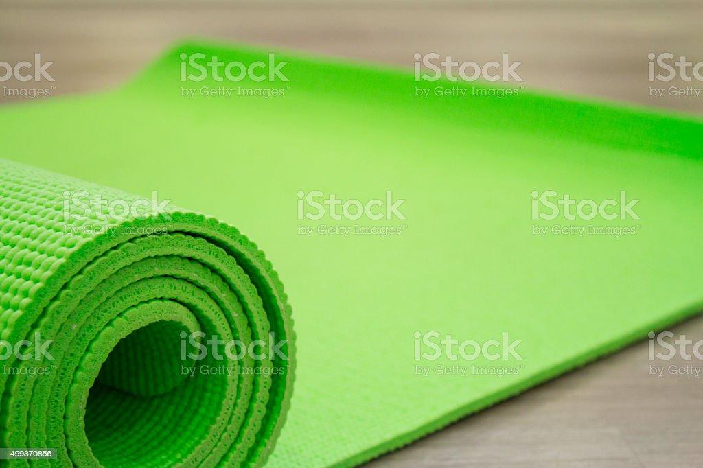 Yoga mat on wooden floor stock photo