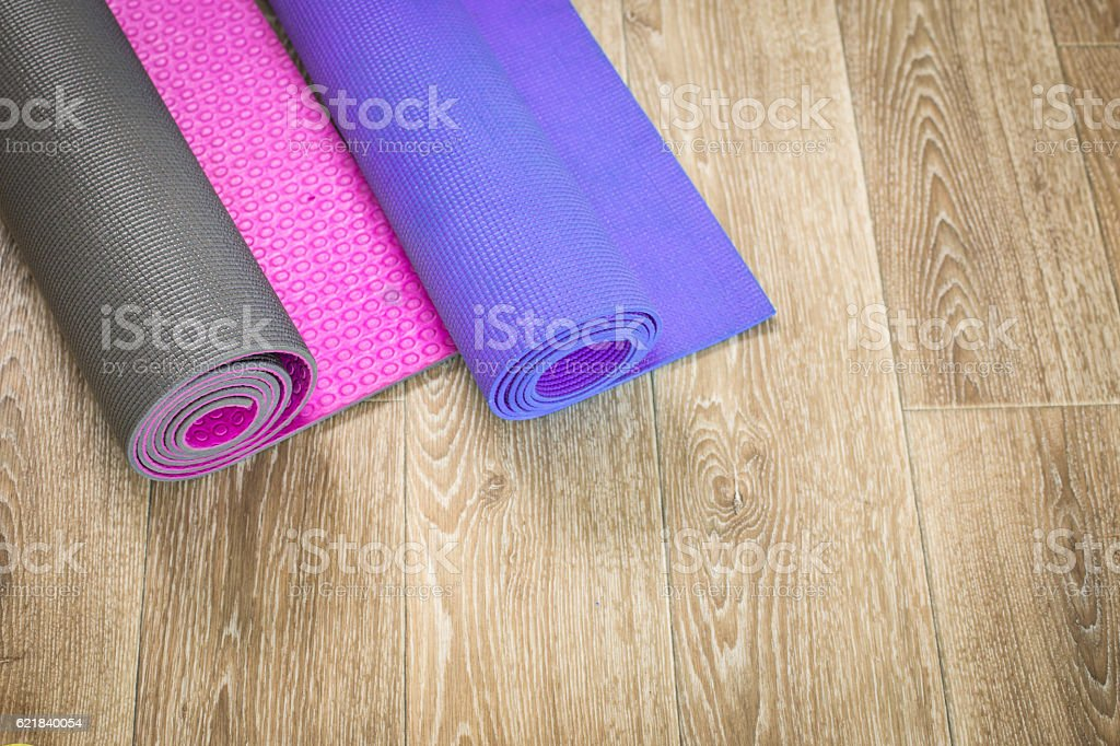 Yoga mats on a wooden background stock photo