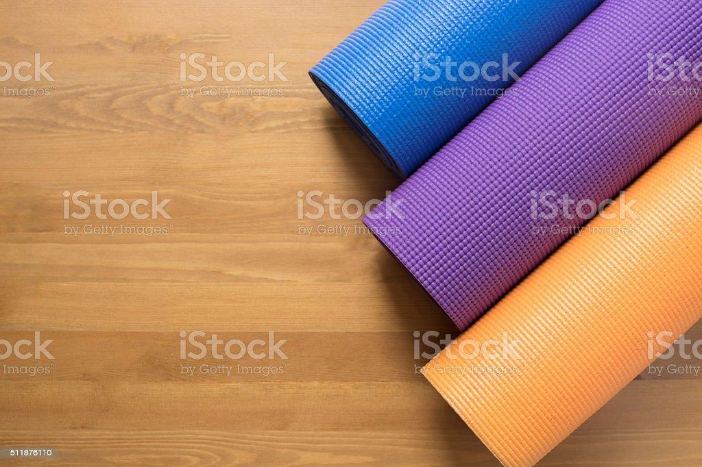 Yoga mats on the wood table stock photo