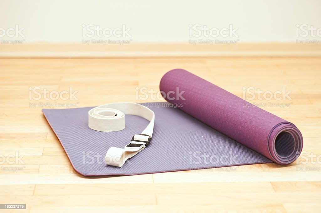 yoga matte on wodden floor royalty-free stock photo