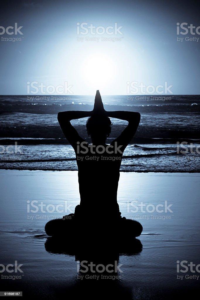 Yoga Meditation at night near the ocean royalty-free stock photo