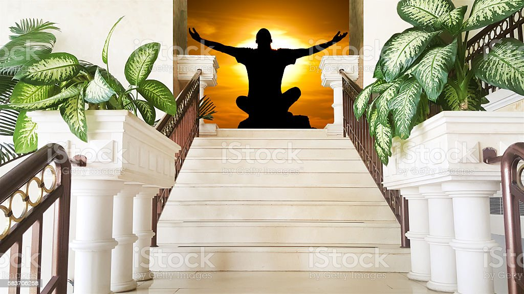 Yoga meditation in pose by man silhouette in background. stock photo