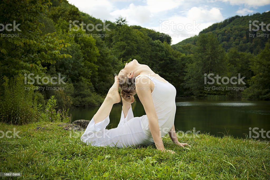 yoga meditation - king cobra stock photo
