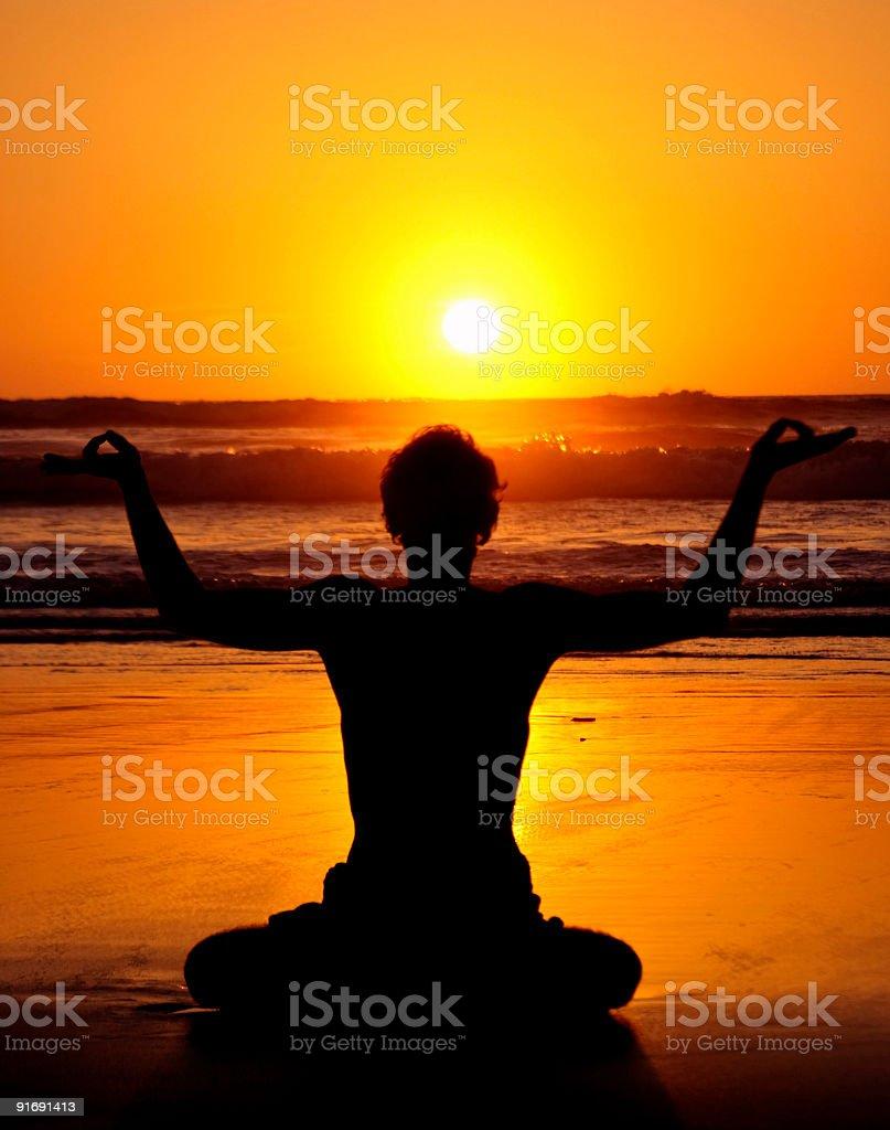 Yoga Meditation Posture at the Atlantic Ocean royalty-free stock photo