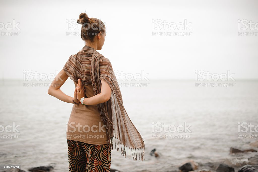Yoga nature spa. The back of a beautiful woman with stock photo