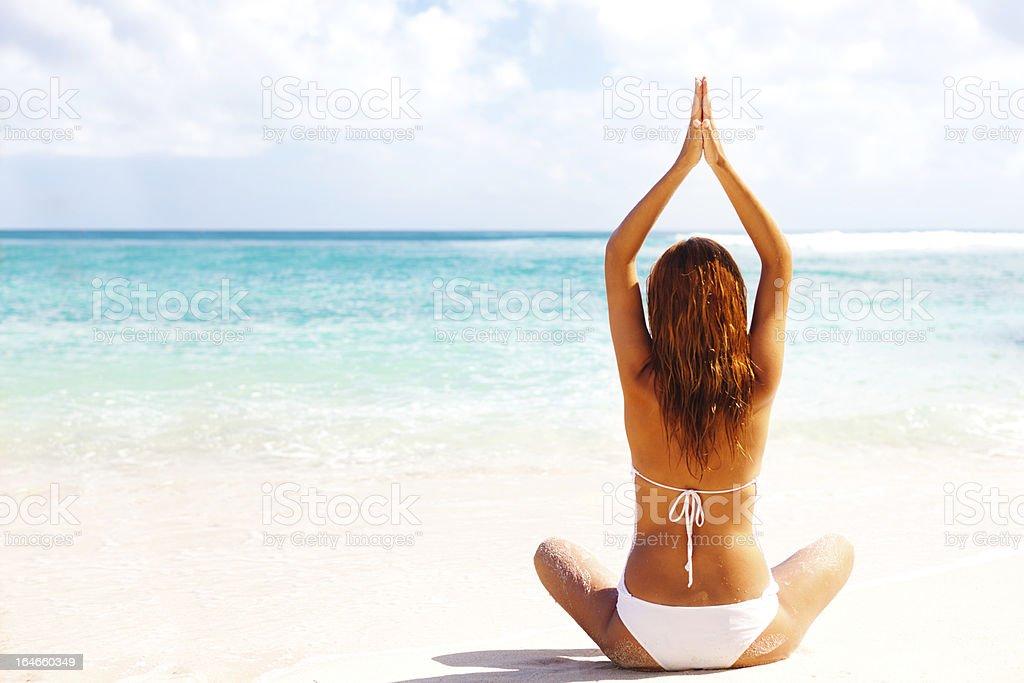 yoga on a beach royalty-free stock photo