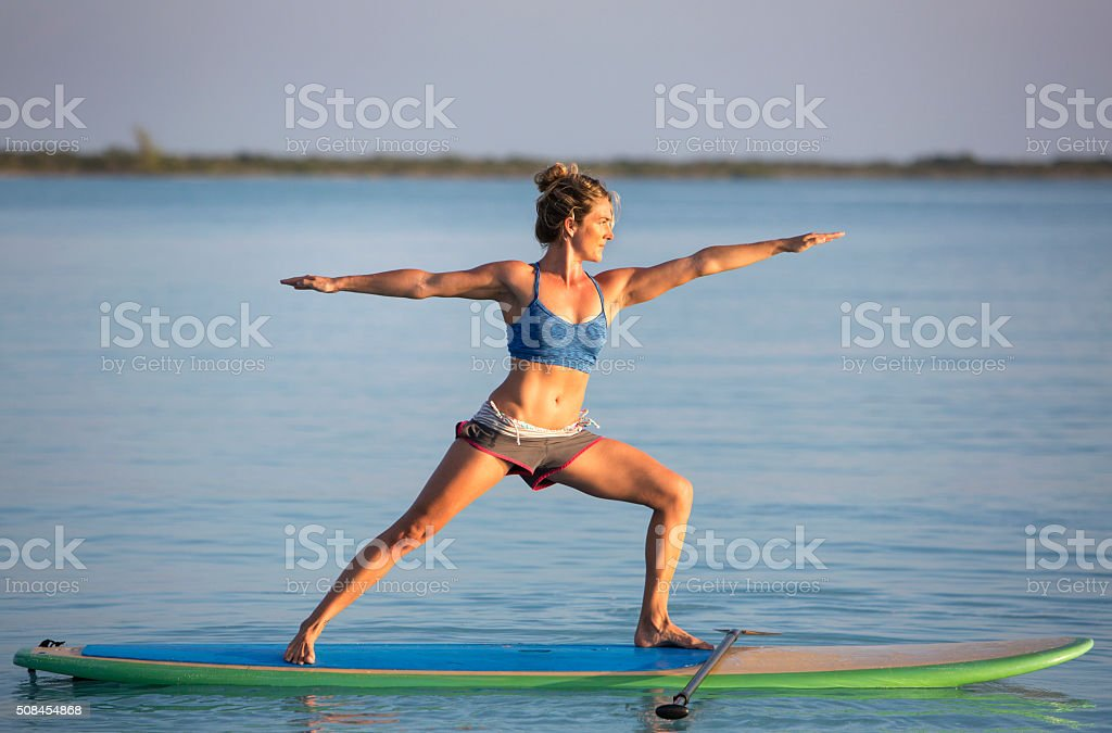 Yoga on a Stand Up Paddle Board stock photo