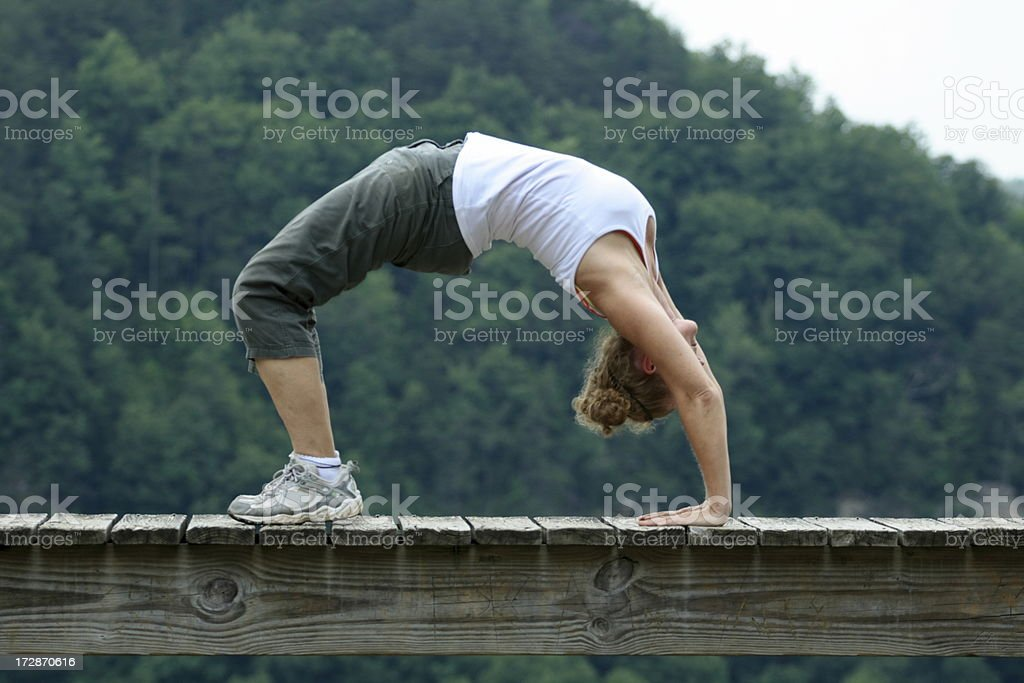 Yoga on Bridge stock photo