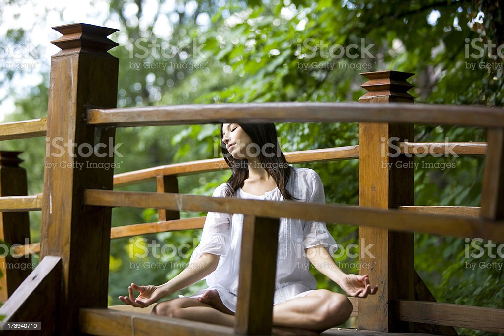 Yoga on bridge royalty-free stock photo