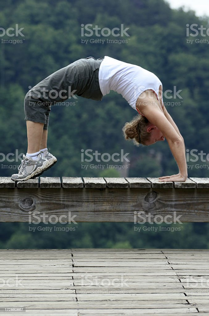 Yoga on Bridge Vertical stock photo