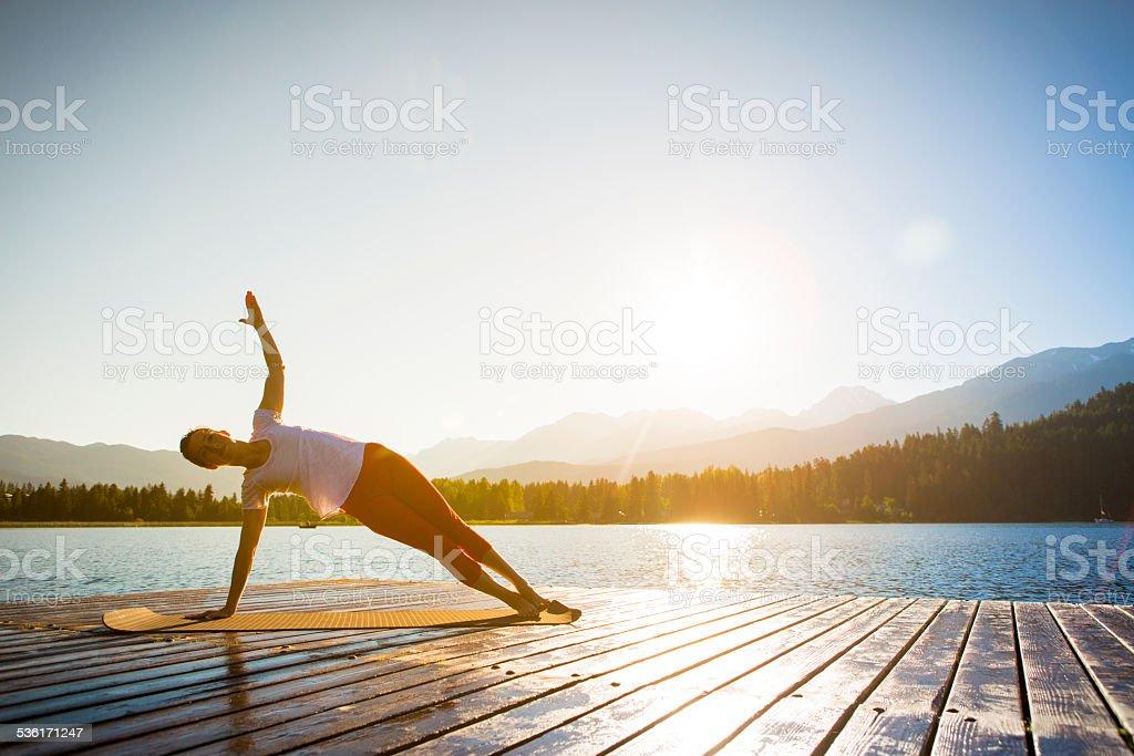 Yoga on lake stock photo