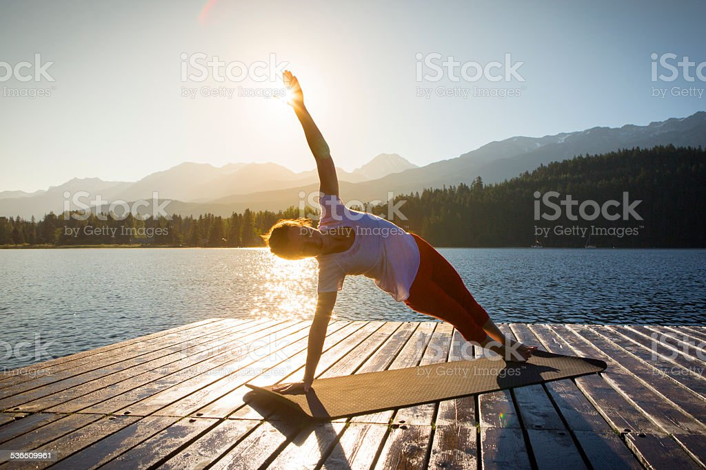 Yoga on lake stock photo