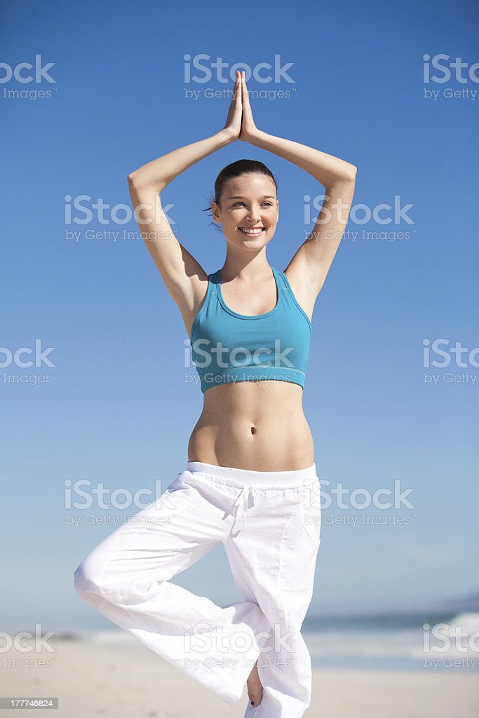 Yoga on the beach royalty-free stock photo