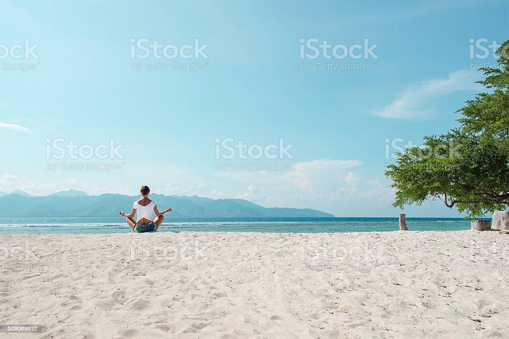 Yoga on the beautiful beach - Stock image stock photo