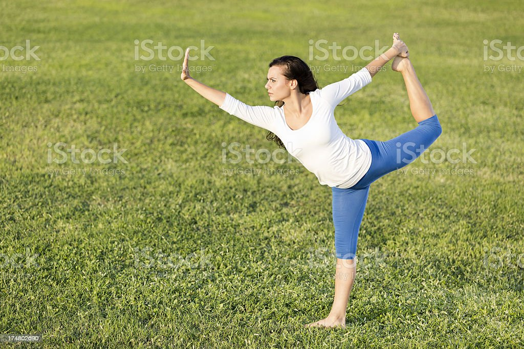 Yoga on the grass royalty-free stock photo