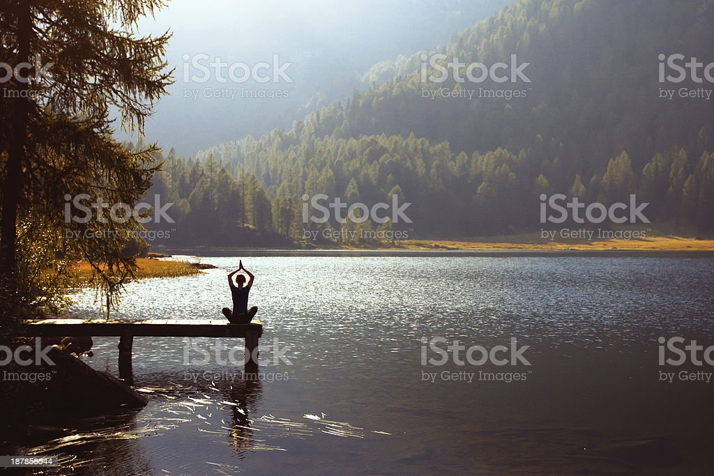 yoga on the lake stock photo