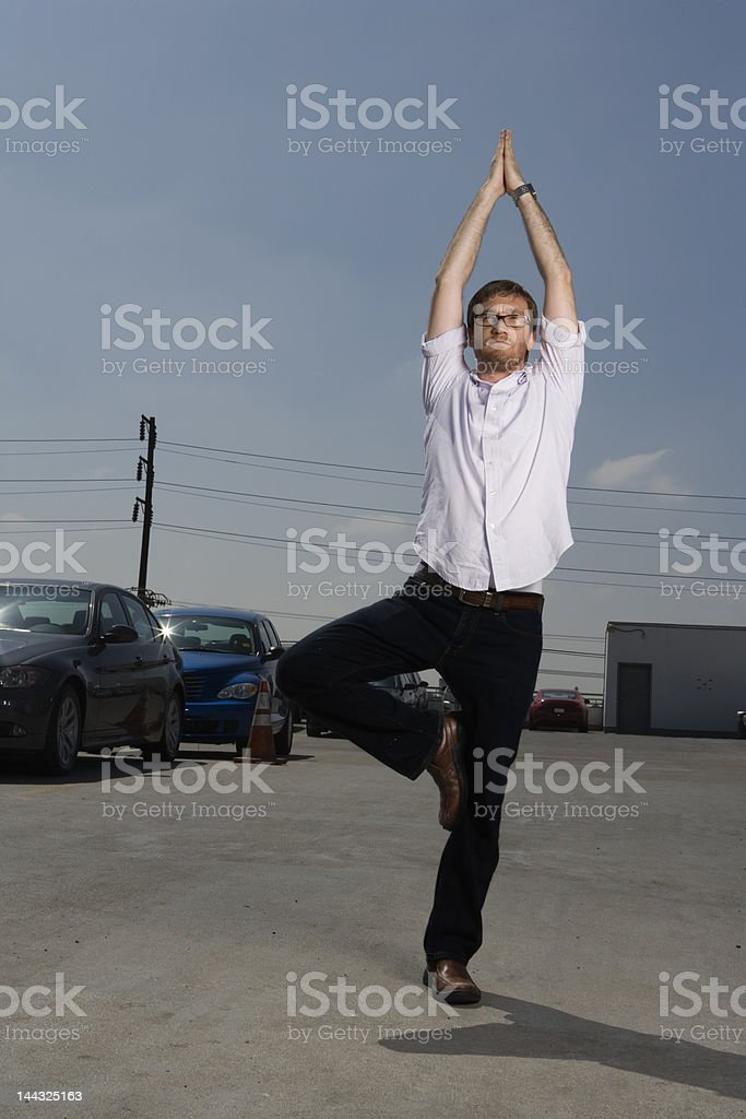 Yoga on top of a parking lot royalty-free stock photo