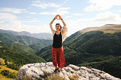Yoga on top of the mountain range