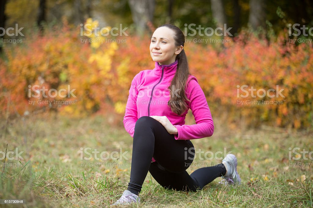 Yoga outdoors: low lunge pose stock photo