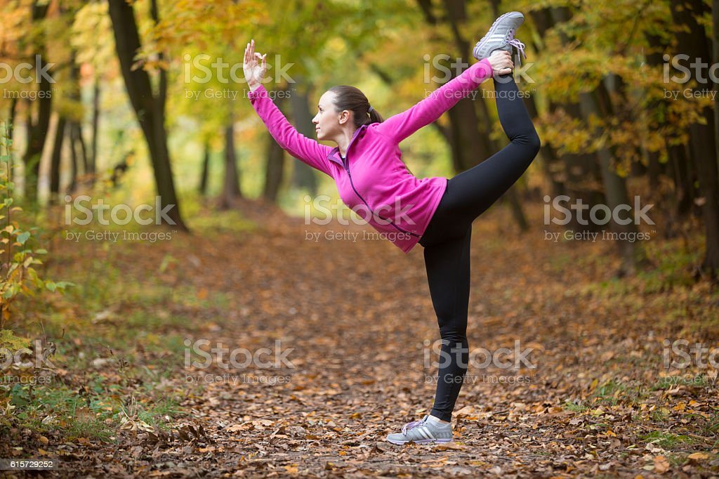 Yoga outdoors: Natarajasana pose stock photo