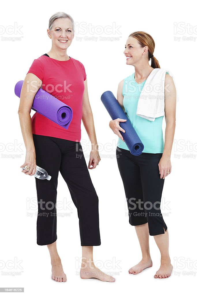 Yoga partners standing isolated on white background royalty-free stock photo