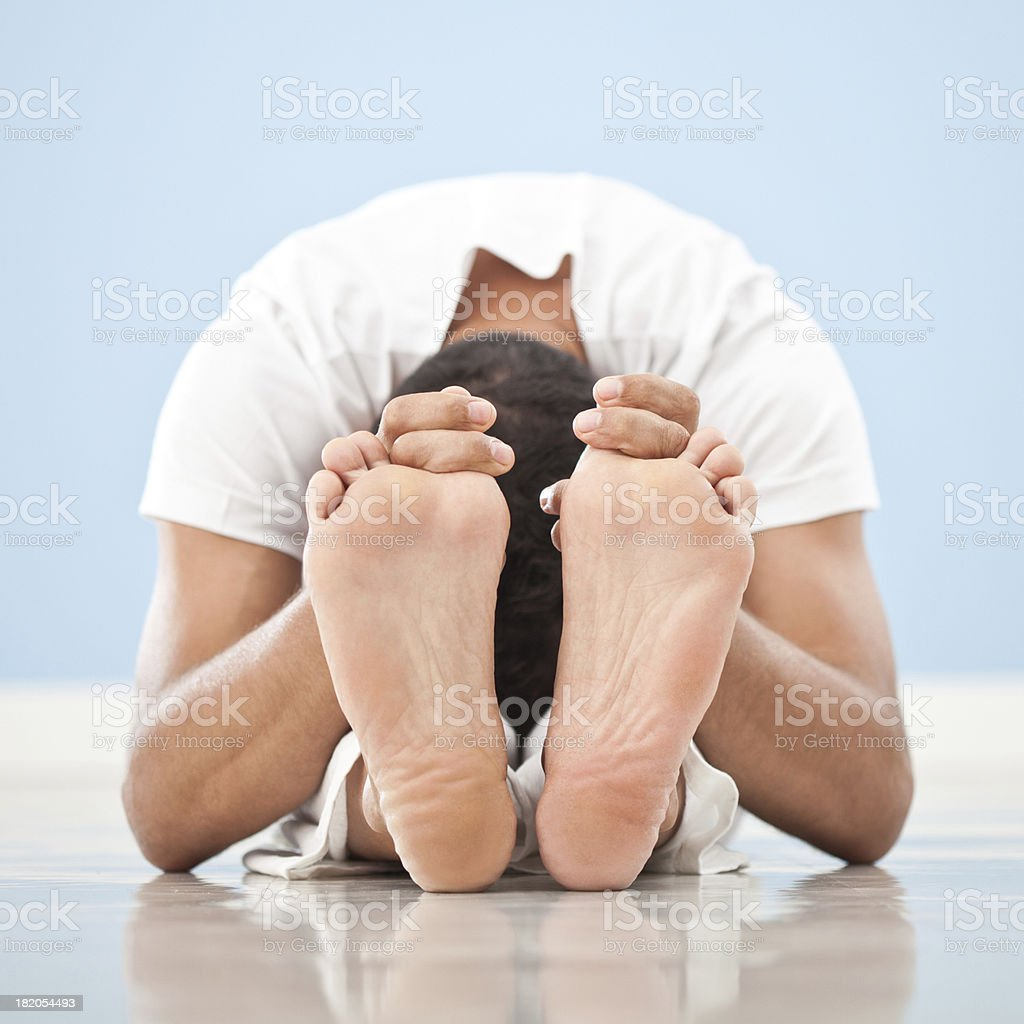 Yoga: Paschimottanasana stock photo