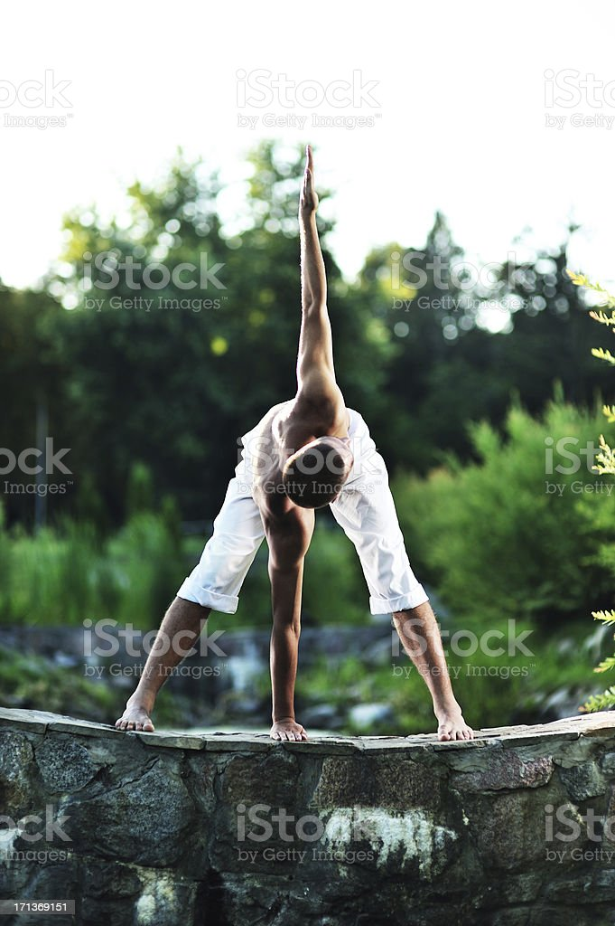 Yoga (Utthita Trikonasana) stock photo