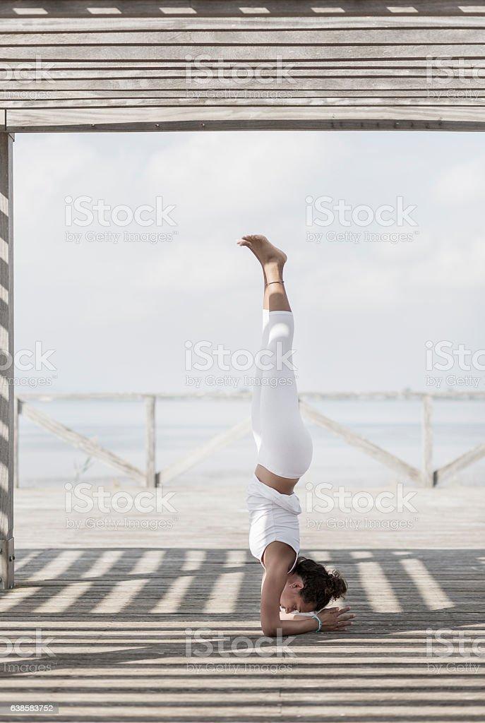 Yoga pinchamayurasana stock photo