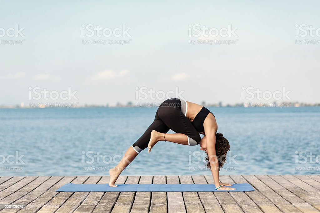 Yoga plank variation pose stock photo