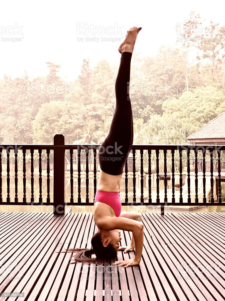 Yoga pose by solo female instructor 156 stock photo