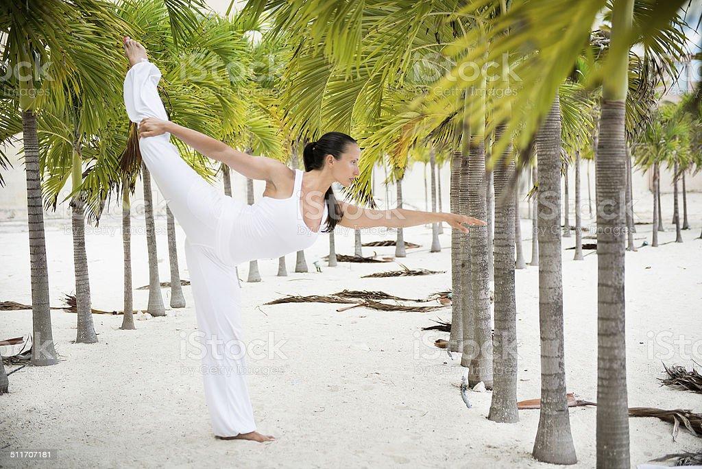 Yoga pose - Dandayamana Dhanurasana stock photo